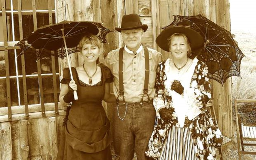 Terri Geissinger, left, one of the organizers of Bodie Days and a historian, enjoys dressing up with Bodie Foundation members David and Diane Herrand. | Bodie.com